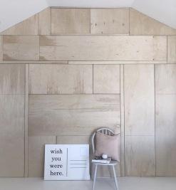 Soo-uK studio space with floor to ceiling ply storage