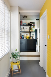 Andrew_Jonathan_Designs_uses yellow_hallway_as_backdrop_for_shelves