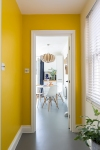 Andrew_Jonathan_Designs_uses_yellow_to_frame_kitchen