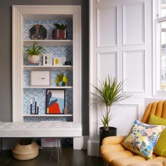 Liznylon_uses_Farrow_and_Ball_Wallpaper_to_update_the_shelves