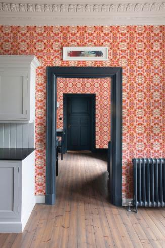 A mod take on period features using Orange feathered wallpaper source: Susi Bellamy