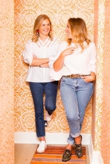 Caroline and Rosie in Caroline's orange wallpapered home