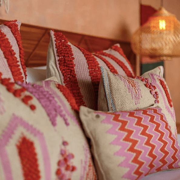 Casa_Palopo_in_guatemala_colourful_handcrafted_cushions_in_pink_and_red