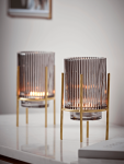 Cox_and_Cox_grey_fluted_tea_light_holder_with_brass_legs