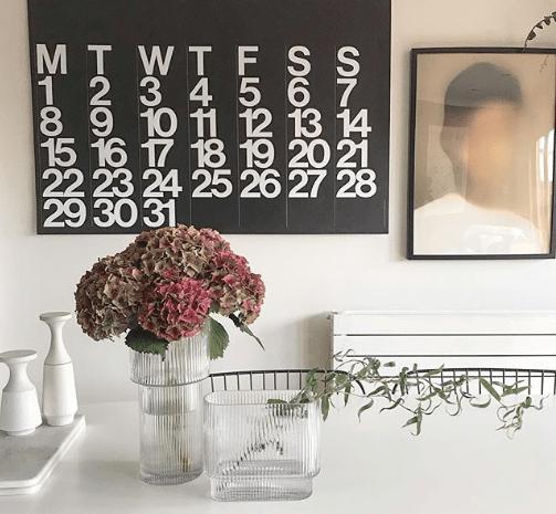 Reeded_glass_vases_in_dining_room_with_hydrangea_flowers_in_PeaceandJam