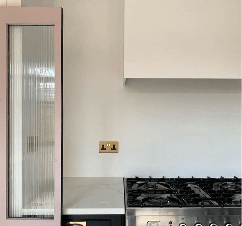 TheHouseThatBlackBuilt_glam_kitchen_in_black_blush_brass_and_reeded_glass_doors