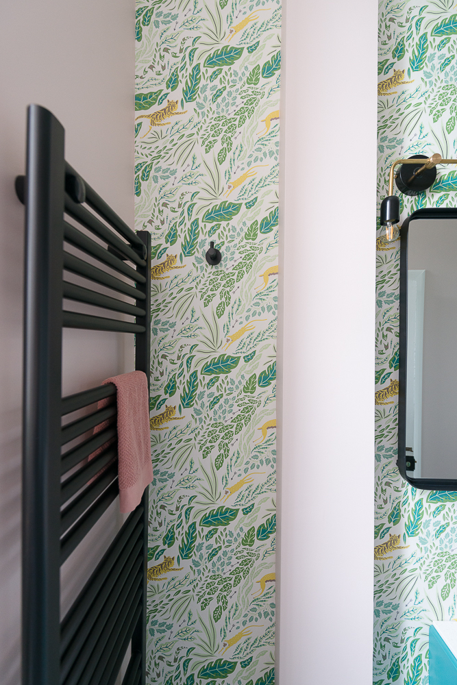 Liznylon_bathroom_pink_and_green_wallpaper_and_black_radiator_and_hook