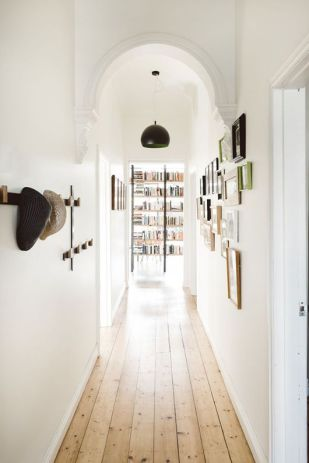 SF_girl_by_the_bay_hallway_with_bookcase_at_end