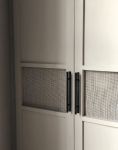 Studio_Hoyna_Cane_doors_that_hide_boiler